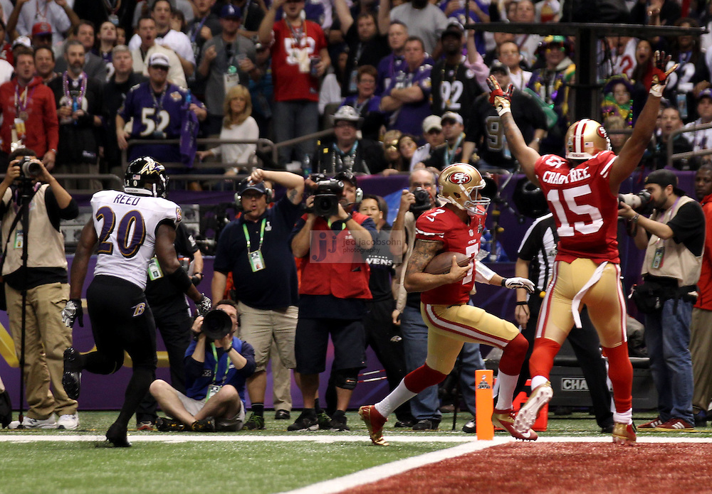 Colin Kaepernick (7) of the San Francisco 49ers runs for a touchdown against the Baltimore Ravens during the NFL Super Bowl XLVII football game in New Orleans on Feb. 3, 2013. The Ravens won the game, 34-31.  (Photo by Jed Jacobsohn)