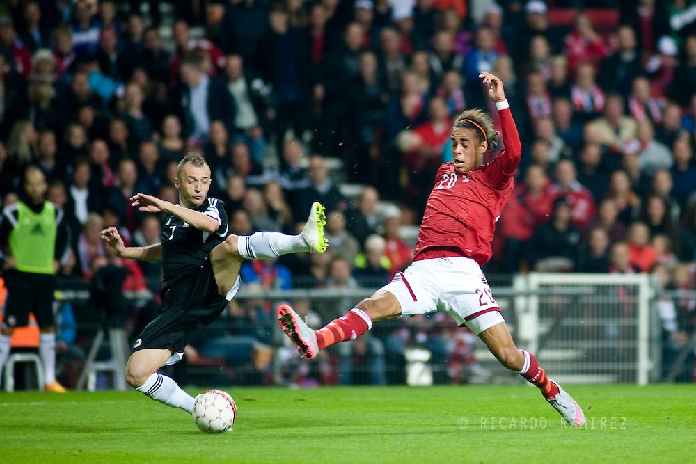 04.09.2015. Copenhagen, Denmark. <br /> Yussuf Poulsen (L) of Denmark fights for the ball with Ansi Agolli (R) of Albania during their UEFA European Champions qualifying round match at the Parken Stadium. <br /> Photo: © Ricardo Ramirez.