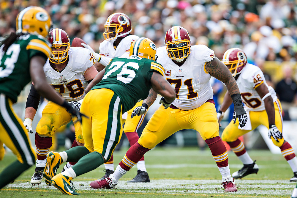 GREEN BAY, WI - SEPTEMBER 15:  Trent Williams #71 of the Washington Redskins blocks against the Green Bay Packers at Lambeau Field on September 15, 2013 in Green Bay, Wisconsin. The Packers defeated the Redskins 38-20.  (Photo by Wesley Hitt/Getty Images) *** Local Caption *** Trent Williams