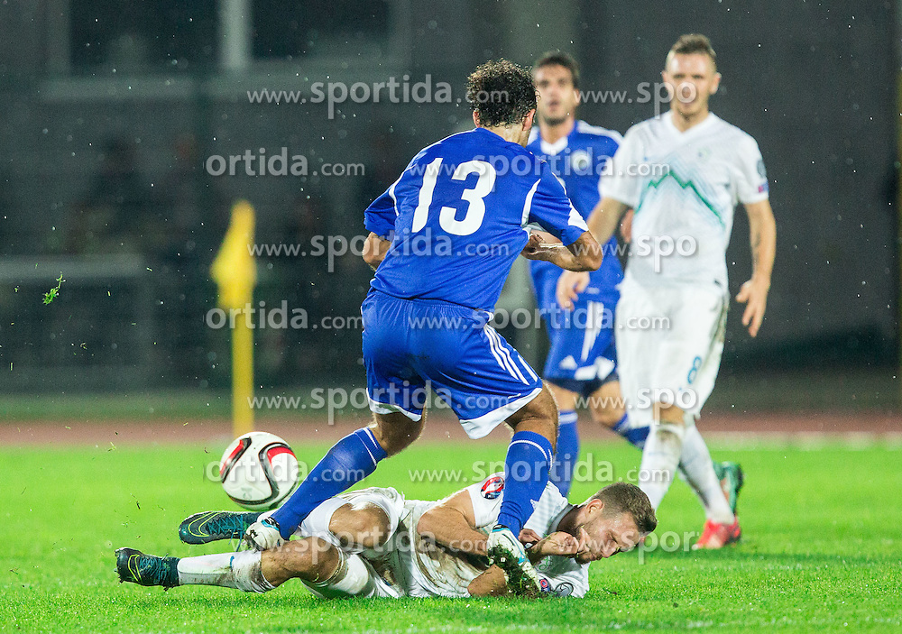 Alex Della Valle of San Marino vs Tim Matavz of Slovenia during football match between National teams of San Marino and Slovenia in Group E of EURO 2016 Qualifications, on October 12, 2015 in Stadio Olimpico Serravalle, Republic of San Marino. Photo by Vid Ponikvar / Sportida