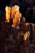 As the sun is setting over Bryce Canyon, only a few hoodos remain lit