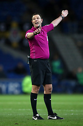 "Match referee James Linington during the Sky Bet Championship match at The Den, London. PRESS ASSOCIATION Photo. Picture date: Friday December 29, 2017. See PA story SOCCER Cardiff. Photo credit should read: Nick Potts/PA Wire. RESTRICTIONS: EDITORIAL USE ONLY No use with unauthorised audio, video, data, fixture lists, club/league logos or ""live"" services. Online in-match use limited to 75 images, no video emulation. No use in betting, games or single club/league/player publications."