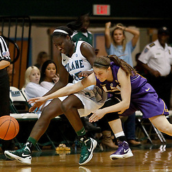 November 19, 2011; New Orleans, LA; LSU Lady Tigers guard Jeanne Kenney (5) collides with Tulane Green Wave forward Adesuwa Ebomwonyi (15) while chasing a loose ball during the second half of a game at Avron B. Fogelman Arena. Tulane defeated LSU 65-62 in overtime. Mandatory Credit: Derick E. Hingle-US PRESSWIRE