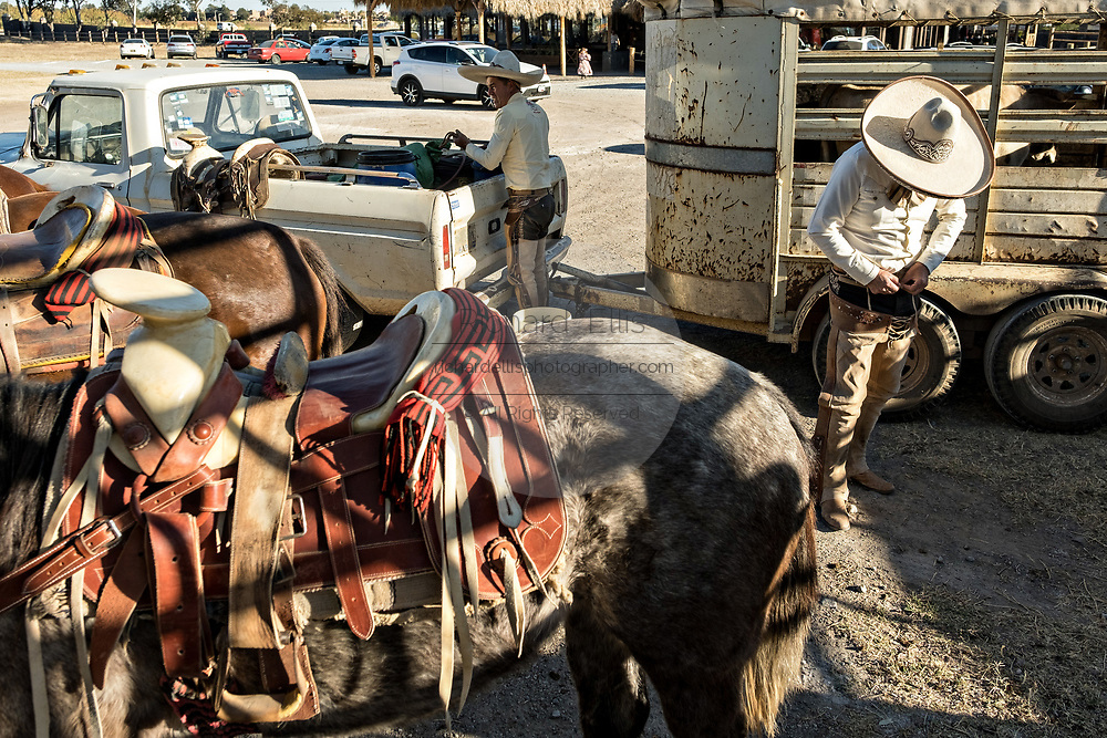 Juan Franco and Luis Alfonso Franco complete dressing in the traditional Charro costume as they read for a family practice session in the Jalisco Highlands town of Capilla de Guadalupe, Mexico. The Franco family has dominated Mexican rodeo for 40-years and has won three national championships, five second places and five third places.