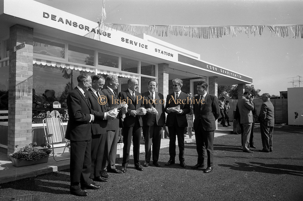 09/08/1967<br /> 08/09/1967<br /> 09 August 1967<br /> Opening of Esso service station at Dean's Grange, Dublin. The site was originally a sculptures yard was a 2-bay service station with the latest equipment. It was to be a 24 hours station and a 5-minute Car Wash and Electronic Tuning was available. Group at the opening. Mr. R.A. Drew, Field Sales Manager, Esso on left;  Mr. F.E. Morton, Branch Manager North, Esso, centre and Mr. P.J. Burke T.D, Chairman, Dublin County Council 3rd from right, are included.
