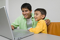 Father and Son Using Laptop