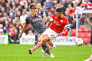 Leeds United midfielder Kalvin Phillips (23) and Barnsley midfielder Alex Mowatt (27) during the EFL Sky Bet Championship match between Barnsley and Leeds United at Oakwell, Barnsley, England on 15 September 2019.
