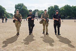 """Soldiers join police officers on Horse Guards Parade in Westminster, London, as armed troops have been deployed to guard """"key locations"""" under Operation Temperer, which is being enacted after security experts warned the Government that another terrorist attack could be imminent."""