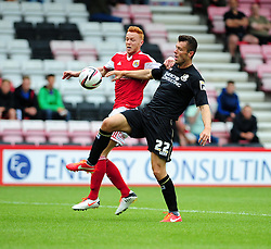 Bristol City's Ryan Taylor jostles for the ball with Bournemouth's Elliot Ward - Photo mandatory by-line: Dougie Allward/JMP - Tel: Mobile: 07966 386802 27/03/2013 - SPORT - FOOTBALL - Goldsands Stadium - Bournemouth -  Bournemouth V Bristol City - Pre Season friendly