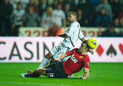 19.11.2011, Liberty Stadion, Swansea, ENG, PL, Swansea City vs Manchester United, 12. Spieltag, im Bild Swansea City's Wayne Routledge in action against Manchester United's Michael Carrick during the Premiership match at the Liberty Stadium. (Pic by David Rawcliffe/Propaganda). EXPA Pictures © 2011, PhotoCredit: EXPA/ Sportida/ David Rawcliff..***** ATTENTION - OUT OF ENG, GBR, UK *****