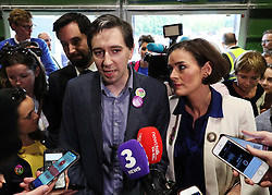 Minister for Health Simon Harris (centre) with Fine Gael's Kate O'Connell speaks to the media on arrival at the count centre in Dublin's RDS as votes are counted in the referendum on the 8th Amendment of the Irish Constitution which prohibits abortions unless a mother's life is in danger. Picture date: Saturday May 26, 2018. See PA story IRISH Abortion. Photo credit should read: Brian Lawless/PA Wire