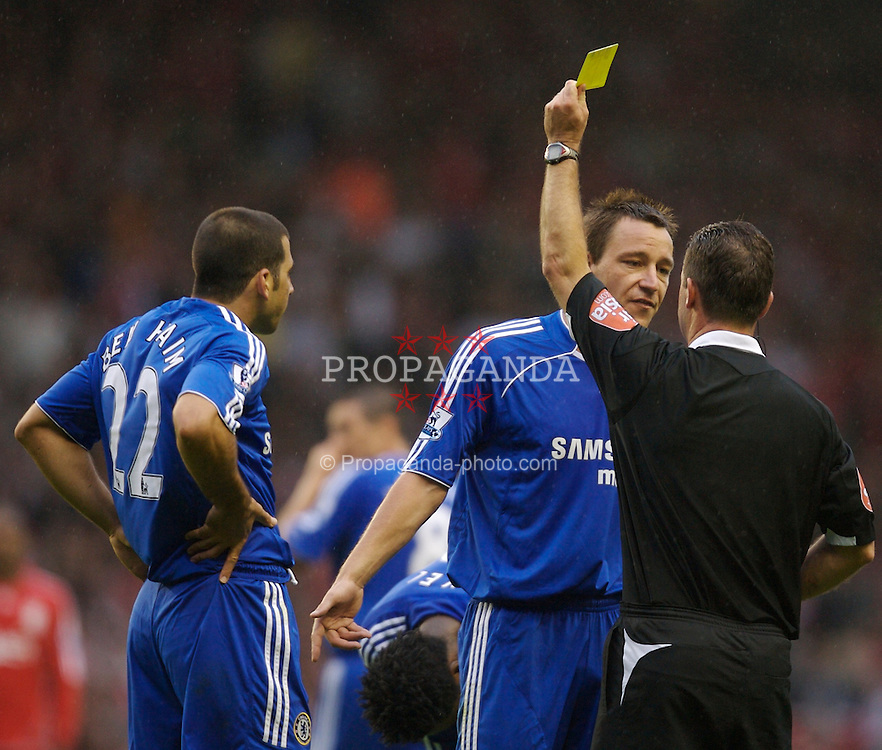 Liverpool, England - Sunday, August 19, 2007: Referee Rob Styles shows the yellow card to Chelsea's John Terry after he argues once too many times during the Premiership match against Liverpool at Anfield. (Photo by David Rawcliffe/Propaganda)