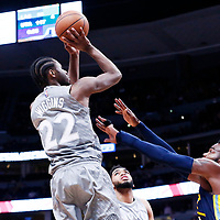 05 April 2018: Minnesota Timberwolves forward Andrew Wiggins (22) takes a jump shot over Denver Nuggets forward Paul Millsap (4) during the Denver Nuggets 100-96 victory over the Minnesota Timberwolves, at the Pepsi Center, Denver, Colorado, USA.