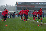 Lincoln City warm up prior to the EFL Sky Bet League 2 match between Lincoln City and Grimsby Town FC at Sincil Bank, Lincoln, United Kingdom on 17 March 2018. Picture by Craig Zadoroznyj.