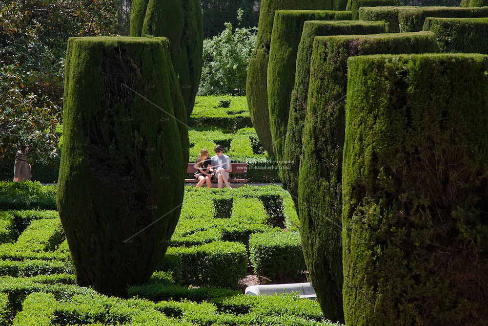 people relaxing in jardines de sabatini madrid