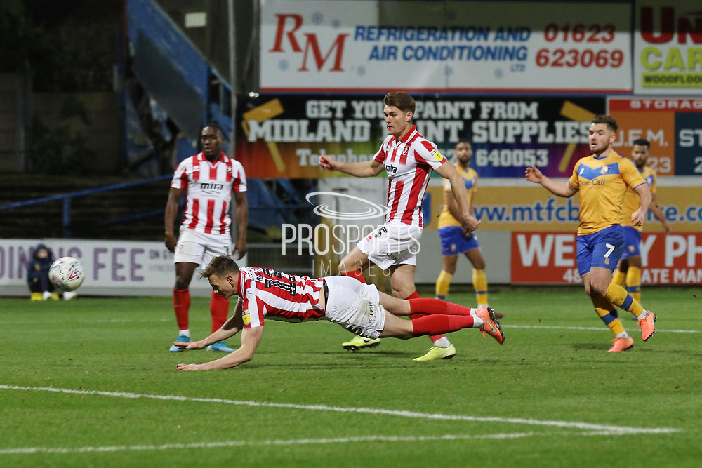 Will Boyle heads in the 2nd goal of the game  during the EFL Sky Bet League 2 match between Mansfield Town and Cheltenham Town at the One Call Stadium, Mansfield, England on 7 December 2019.