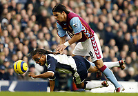 Photo: Chris Ratcliffe.<br />Tottenham Hotspur v Aston Villa. The Barclays Premiership. 21/01/2006.<br />Milan Baros (R) pushes Edgar Davids of Spurs to the ground on his way through.