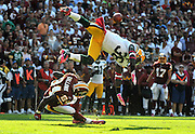 Green Bay Packers safety Nick Collins collides with Washington Redskins wide receiver Joey Galloway at FedEx Field in Landover, Maryland.