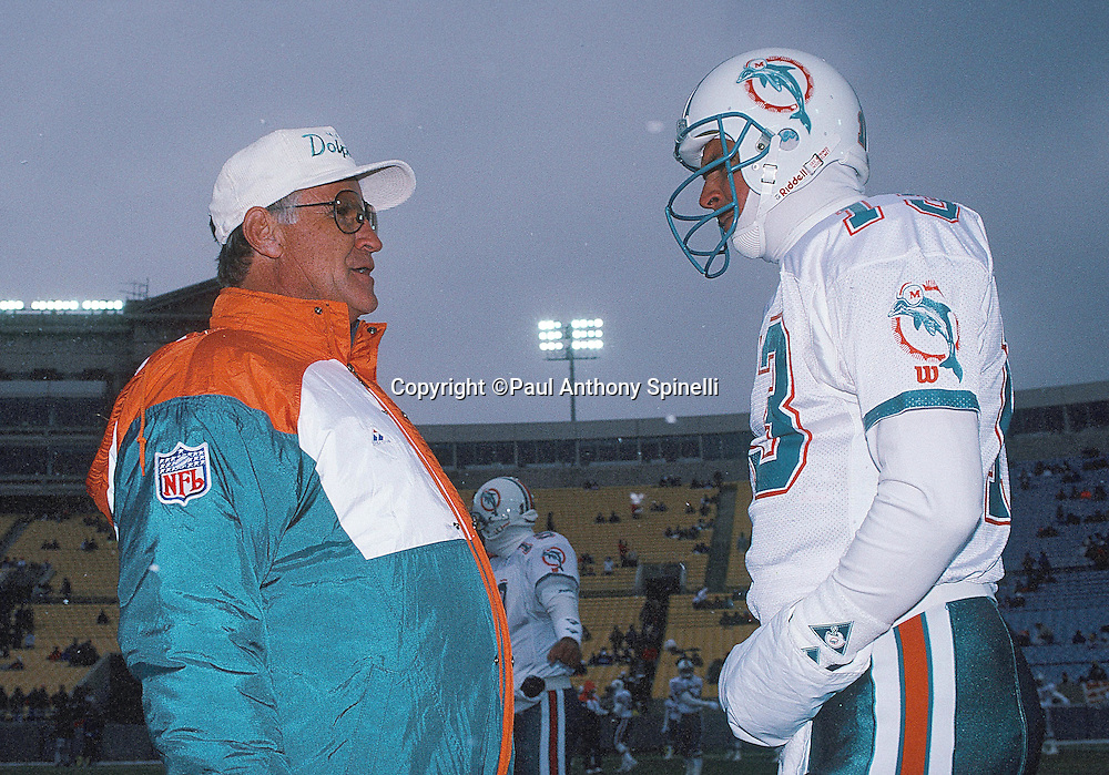 Miami Dolphins head coach Don Shula talks on the sideline to Miami Dolphins quarterback Dan Marino (13) during the NFL football game against the Chicago Bears on Nov. 24, 1991 in Chicago. The Dolphins won the game 16-13. (©Paul Anthony Spinelli)