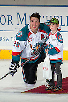 KELOWNA, CANADA -FEBRUARY 1: Myles Bell #29 of the Kelowna Rockets accepts the first star of the game against the Kamloops Blazers after scoring 4 goals on February 1, 2014 at Prospera Place in Kelowna, British Columbia, Canada.   (Photo by Marissa Baecker/Getty Images)  *** Local Caption *** Myles Bell;