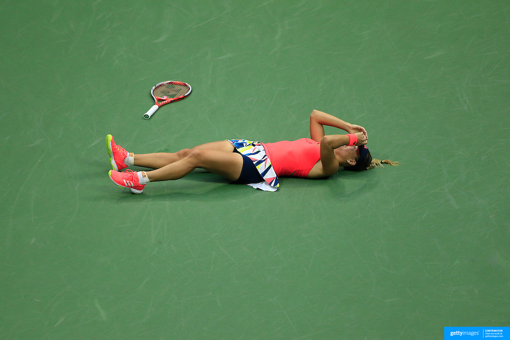 2016 U.S. Open - Day 13  Angelique Kerber of Germany celebrates collapses onto the court after winning the Women's Singles Final against Karolina Pliskova of the Czech Republic on Arthur Ashe Stadium on day thirteen of the 2016 US Open Tennis Tournament at the USTA Billie Jean King National Tennis Center on September 10, 2016 in Flushing, Queens, New York City.  (Photo by Tim Clayton/Corbis via Getty Images)