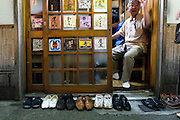 "Shoes are lined up outside one of the 47 bars along Nonbeiyokocho, or ""Drnkard's Alley"" in Shibuya, Tokyo. Customers wander past bars in the Golden Gai district of Shinjuku, Tokyo, Japan. Nonbeiyokocho began life immediately after World War II as group of tea houses. Though the alley is just a short walk from the central Shibuya shopping district, the rents are low due to the area being built over a river. Today 47 eateries, each with barely enough room to swing a cat, serve beer, fine wines and good, inexpensive fare."