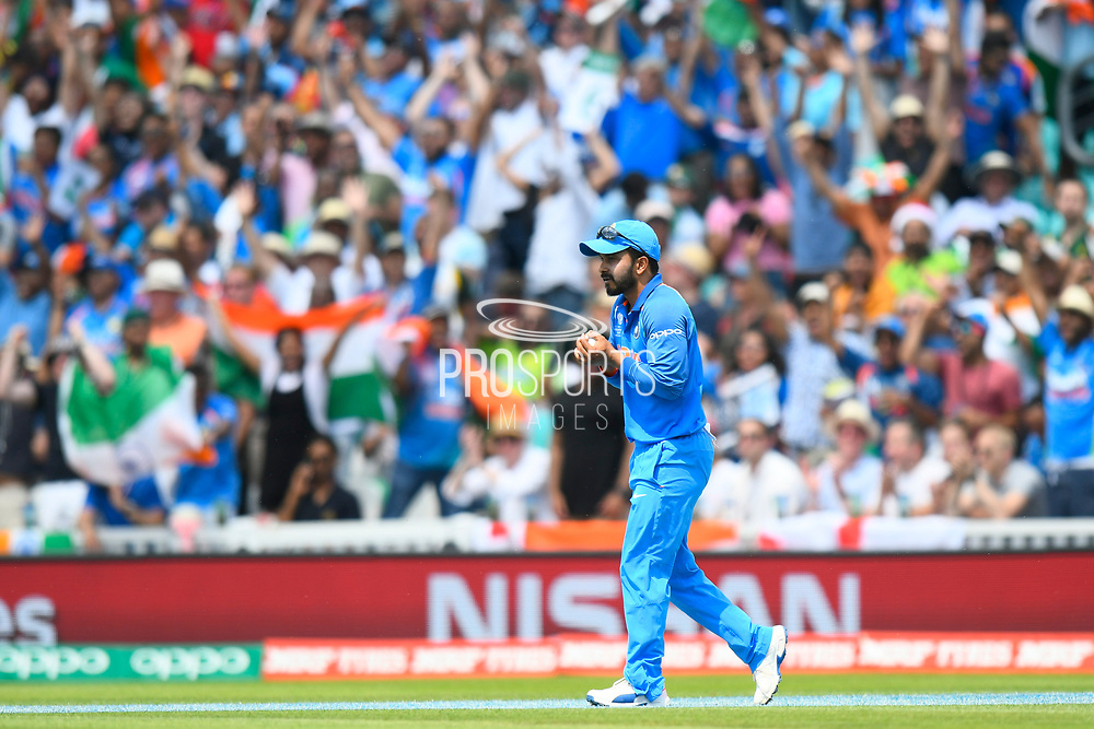 Wicket - Kedar Jadhav of India takes the catch which dismissed Shoaib Malik of Pakistan during the ICC Champions Trophy final match between Pakistan and India at the Oval, London, United Kingdom on 18 June 2017. Photo by Graham Hunt.