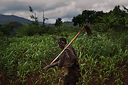 A man walk along a dirt path near Butare in Rwanda's Southern Province. The Simbi Area Development Program (ADP) located here is one of many long-term development initiatives led by the international nonprofit World Vision. Area Development Programs work within communities like Butare over a period of several years, providing developmental resources to foster long-term, sustainable growth in the economic and physical well being of the community.