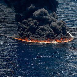 A controlled burn is seen from the air near the source of the BP Plc Deep Water Horizon oil spill site in the Gulf of Mexico off the coast of Louisiana, U.S., on Sunday, July 11, 2010. Oil is once again gushing freely into the Gulf of Mexico as BP Plc is in the process of changing out the cap from the leaking well and plans to have a new cap installed over the next few days that will allow for oil to be captured efficiently. Photographer: Derick E. Hingle/Bloomberg