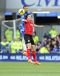 Hull City's Liam Rosenior battles for the high ball with Cardiff City's Don Cowie - Photo mandatory by-line: Joe Meredith/JMP - Tel: Mobile: 07966 386802 22/02/2014 - SPORT - FOOTBALL - Cardiff - Cardiff City Stadium - Cardiff City v Hull City - Barclays Premier League