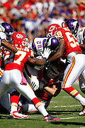 Minnesota Vikings running back Adrian Peterson (28) gets gang tackled on a first quarter run during the NFL week 4 football game against the Kansas City Chiefs on Sunday, October 2, 2011 in Kansas City, Missouri. The Chiefs won the game 22-17. ©Paul Anthony Spinelli