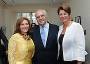 Hunter College President Jennifer J. Raab. left, poses with Norman Benzaquen, center, and Hunter alumna Judy Zankel at the Hunter College Summer Garden Party, Tuesday, July, 8, 2014, at Roosevelt House in New York.   (Photo by Diane Bondareff/Invision for Hunter College/AP Images)
