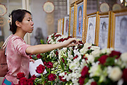 Apr. 15, 2010 - BANGKOK, THAILAND:  A woman makes an offering at the casket of a victim of Thai political violence during a chanting service at Wat Hualamphong in central Bangkok Thursday for the people who died during anti-government street violence Saturday. Another protestor died today, bringing the civilian death toll to 17. Hundreds of people are still hospitalized and many are in intensive care. Officials expect the death toll to increase through the week as people die of their wounds. A date has not been set for the victims' Buddhist funeral rites, but the chanting services will continue on a daily basis until the dead are cremated. Many people believe a violent government crackdown is less likely now since the violence seems to have shocked many Thais, but it has also galvanized protestors who show no sign of backing down.   Photo By Jack Kurtz