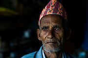 6th May 2015, Kathmandu, Nepal.  Chandra Bahadur Puri (83) in his home in Bimdungar village, near Kathmandu, on the 6th May 2015.<br /> <br /> He lived through the last major earthquake to hit Nepal 81 years ago in 1934. He remembers nothing of the first earthquake but said their house survived. During the 2015 earthquake he was outside his house sweeping, but fell down because the ground was shaking so violently and crawled a few metres away and in that time the house collapsed, luckily no one was inside at the time.<br /> <br /> An earthquake with magnitude 7.8 occurred near Lamjung, Nepal, 50 miles northeast of the capital Kathmandu at 06:11:26 UTC on Apr 25, 2015. The capital has seen considerable devastation including the nine-story Dharahara Tower, one of Kathmandu's landmarks built by Nepal's royal rulers as a watchtower in the 1800s and a UNESCO-recognised historical monument. It was reduced to rubble and there were reports of people trapped. Portions of historic buildings in the World Heritage gazetted site of Patan have also been destroyed as well as many buildings in the old city. <br /> <br /> PHOTOGRAPH BY AND COPYRIGHT OF SIMON DE TREY-WHITE<br /> <br /> + 91 98103 99809<br /> email: simon@simondetreywhite.com<br /> photographer in delhi