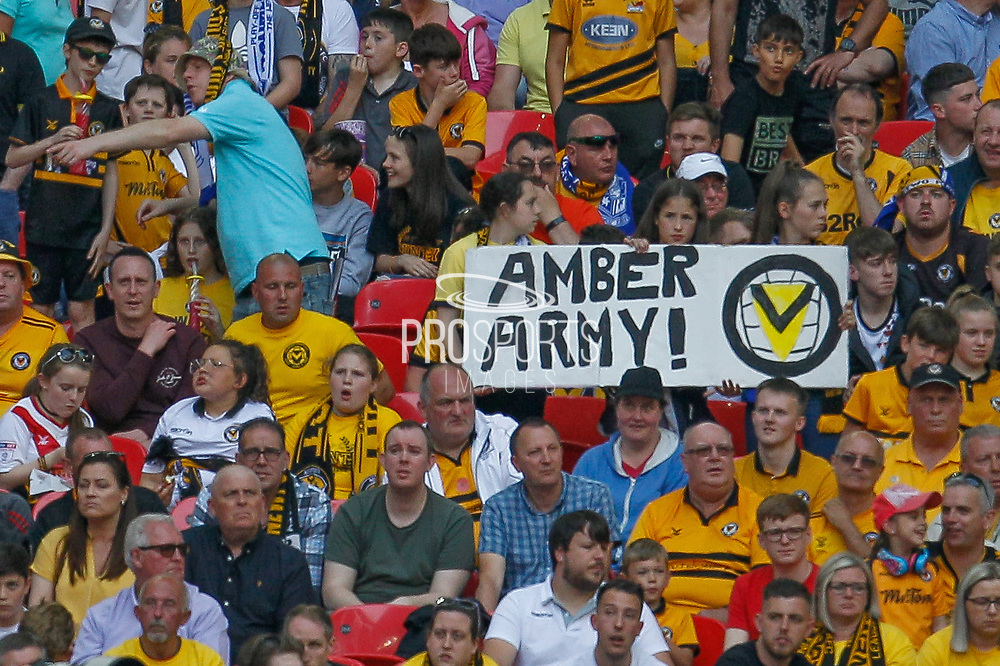 Newport County football fans, football supporters, Amber Army banner during the EFL Sky Bet League 2 Play Off Final match between Newport County and Tranmere Rovers at Wembley Stadium, London, England on 25 May 2019.