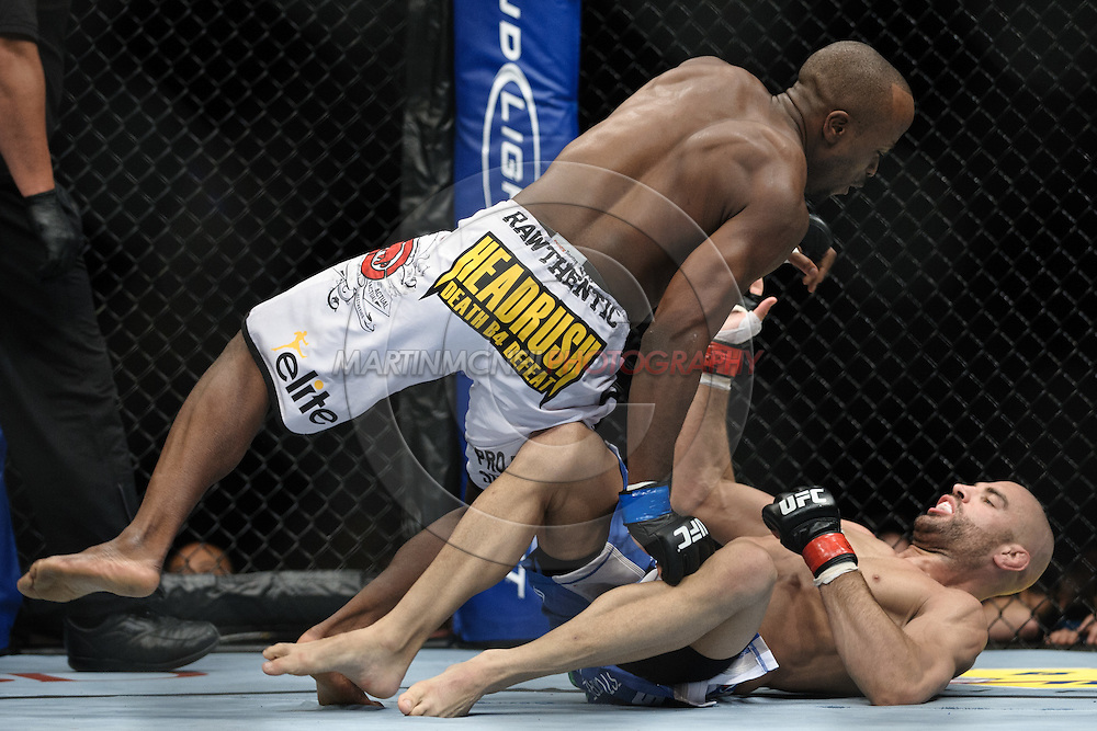 """LONDON, ENGLAND, OCTOBER 2010: Claude Patrick (top) tries to power past the guard off James Wilks during """"UFC 120: Bisping vs. Akiyama"""" inside the O2 Arena in Greenwich, London"""