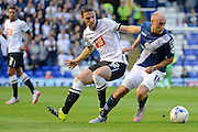 David Cotterill and Chris Baird tussle during the Sky Bet Championship match between Birmingham City and Derby County at St Andrews, Birmingham, England on 21 August 2015. Photo by Alan Franklin.
