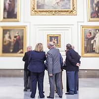 Visitors in the room V (Sevillian Baroque), Museum of Fine Arts, Seville, Spain. Tilted lens used for shallower depth of field.
