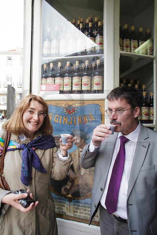 """Tourists at """"Ginjinha"""" in Lisbon, drinking cherry liquor (ginjinha)."""