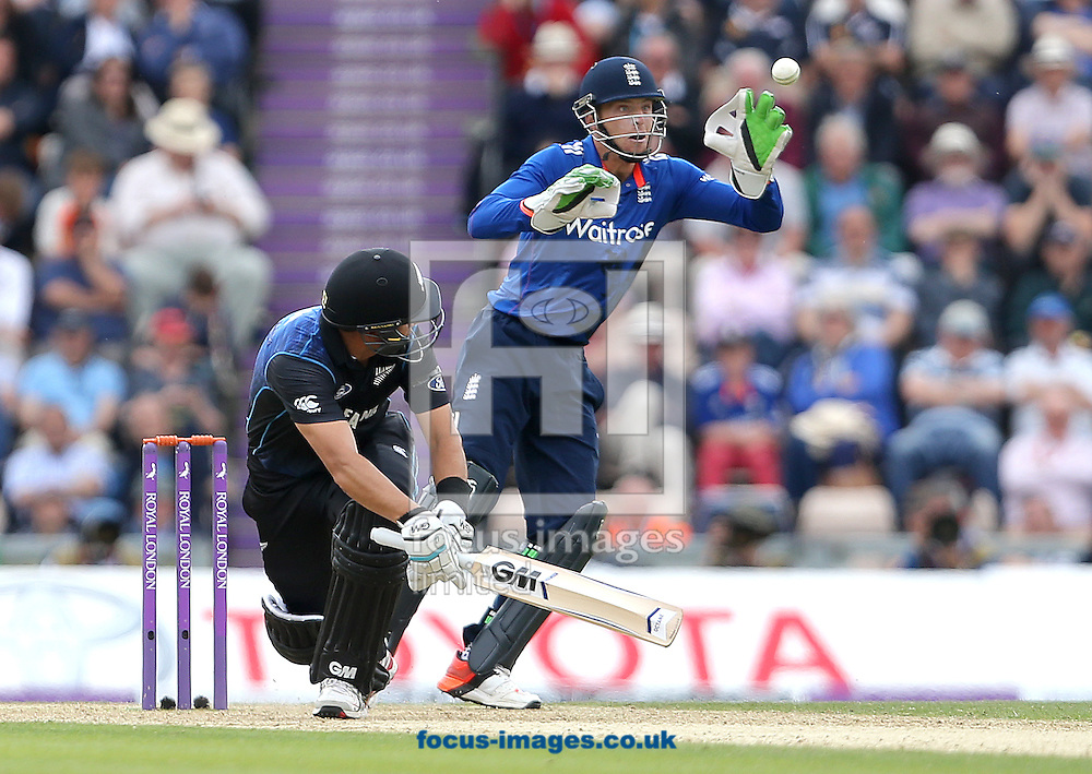Ross Taylor of New Zealand plays the ball past Jos Butler of England during the Royal London One Day Series match at the Ageas Bowl, West End<br /> Picture by Paul Terry/Focus Images Ltd +44 7545 642257<br /> 14/06/2015