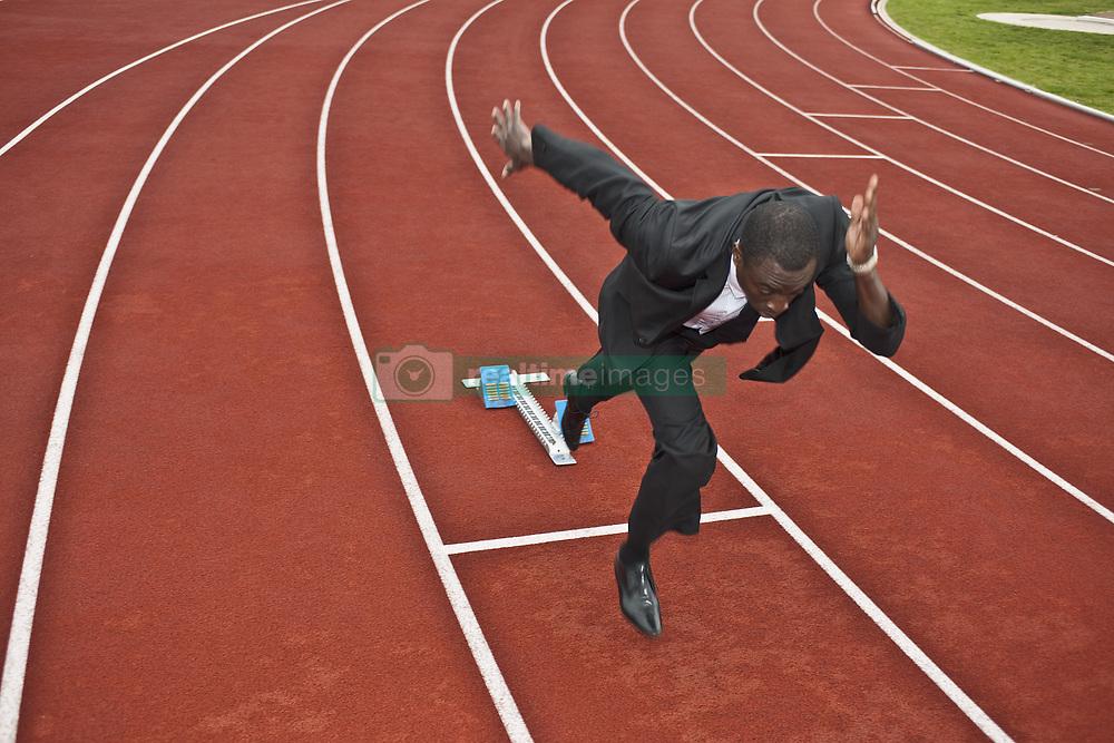 Oct. 11, 2009 - businessman sprinting on running track. Model and Property Released (MR&PR) (Credit Image: © Cultura/ZUMAPRESS.com)