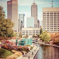 Indianapolis skyline old retro picture with Canal Walk and downtown Indianapolis city buildings. The Indiana Central Canal was built in the 1800s and Canal Walk serves as a recreational attraction. Picture has a 1960s retro vintage tone applied.