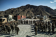 French troops make a last briefing before leaving Nejrab base on September 21, 2012. The 16th BC unit from Bitche (Moselle) had left that morning to join the Nejrab base with all hardware in contenairs. They will depart after the briefing for the Warehouse French base in Kabul, where they will spend a week disassembling their weapons, cleanning their tanks and preparing their departure for France. AFP PHOTO / JEFF PACHOUD
