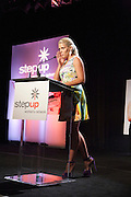 Actress Busy Philipps presents on stage.