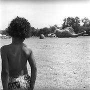 Child looking at dragon in the field, Glastonbury, Somerset, 1989