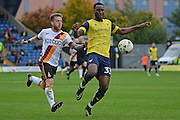 Bradford City striker Billy Clarke (10) closes down Oxford United defender Cheyenne Dunkley (33) 0-0 during the EFL Sky Bet League 1 match between Oxford United and Bradford City at the Kassam Stadium, Oxford, England on 15 October 2016. Photo by Alan Franklin.