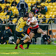Ben Lam bumps-off Lions player during the Super rugby (Round 12) match played between Hurricanes  v Lions, at Westpac Stadium, Wellington, New Zealand, on 5 May 2018.  Hurricanes won 28-19.