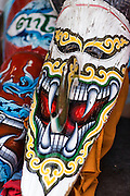 """29 JUNE 2014 - DAN SAI, LOEI, THAILAND:  Phi Ta Khon masks at Wat Ponchai during the """"Ghost Festival."""" Phi Ta Khon (also spelled Pee Ta Khon) is the Ghost Festival. Over three days, the town's residents invite protection from Phra U-pakut, the spirit that lives in the Mun River, which runs through Dan Sai. People in the town and surrounding villages wear costumes made of patchwork and ornate masks and are thought be ghosts who were awoken from the dead when Vessantra Jataka (one of the Buddhas) came out of the forest. On the last day of the festival people participate in merit making ceremonies at the Wat Ponchai in Dan Sai and lead processions through town soliciting donations for the temple.    PHOTO BY JACK KURTZ"""