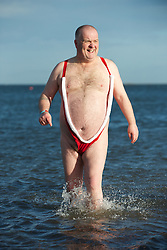 © Licensed to London News Pictures. 01/01/2013..Redcar, England..Colin Ward, 55 from Middlesbrough braves the chilly north sea on New Year's Day...The annual New Year's Day dip goes down with a splash as people brave the chilly north sea to mark the beginning of a new year with an early morning dip at the beach in Redcar, Cleveland...Photo credit : Ian Forsyth/LNP