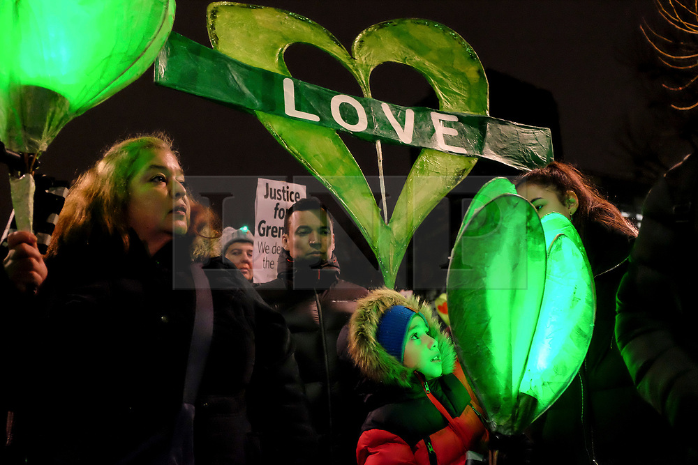 © Licensed to London News Pictures. 14/01/2018 London, UK. Hundreds pay tribute in a 'silent march' demanding justice for the Grenfell Tower victims seven months after the fire the claimed 71 lives. Survivors, relatives and supporters gathered outside the Notting Hill Methodist Church and walked in silence through Ladbroke Grove stopping traffic in an community organised action repeated on the same night of every month since the devastating events 14 June 2017. The inquiry continues.<br /> Photo credit: Guilhem Baker/LNP